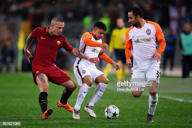 Taison of Shakhtar Donetsk is challenged by Radja Nainggolan of AS Roma during the UEFA Champions League Round of 16 Second Leg match between AS Roma...