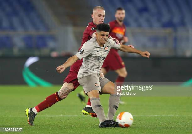 Taison of Shakhtar Donetsk is challenged by Rick Karsdorp of A.S Roma during the UEFA Europa League Round of 16 First Leg match between AS Roma and...