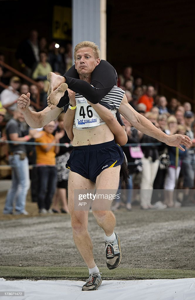 Taisto Miettinen and Kristiina Haapanen from Finland win the Wife Carrying World Championships in Sonkajarvi, Finland on July 6, 2013.