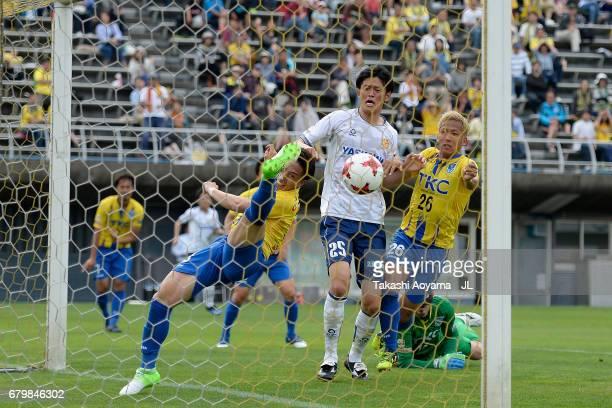 Taisuke Miyazaki of Tochigi SC clears the ball off the goal line during the JLeague J3 match between Tochigi SC and Giravanz Kitakyushu at Tochigi...