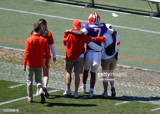 Taisun Phommachanh of the Clemson Tigers is helped off the field following an injury during the second half of the Clemson Orange and White Spring...