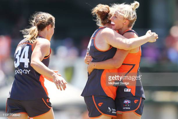 Tait Mackrill of GWS celebrates a goal with Christina Bernadi of GWS during the AFLW Rd 4 match between Collingwood and GWS at Morwekk Recreation...