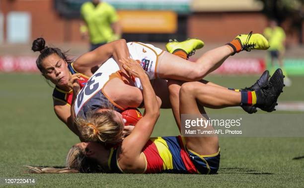 Tait Mackrill of the Giants is tackled by Justine Mules and Anne Hatchard of the Crows during the 2020 AFLW Round 06 match between the Adelaide Crows...
