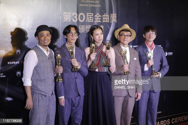 Taiwan aboriginal singer Yawai Mawlin and her group pose with their trophies after winning the Best Aboriginal Album at the 30th Golden Melody Awards...