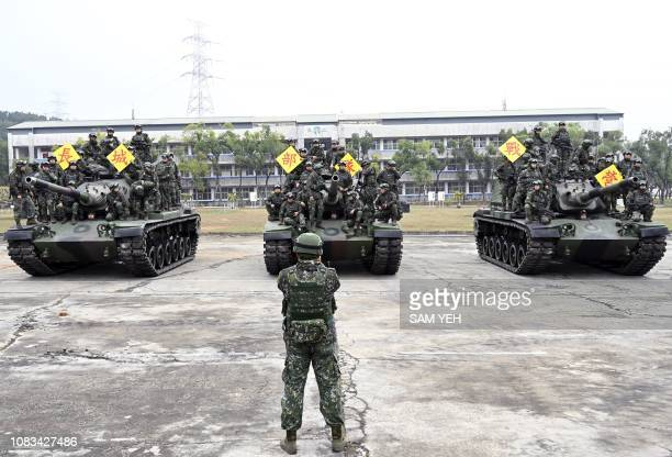 Taiwan army soldiers pose for photos on USmade M60A3 tanks after a lifefire exercise in Taichung central Taiwan on January 17 2019