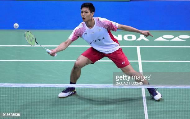 Taiwan badminton player Chou Tien Chen plays a return against Chinese badminton player Qiao Bin during their men's singles semifinal badminton match...