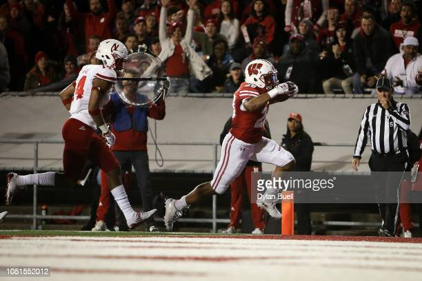 Taiwan Deal of the Wisconsin Badgers scores a touchdown in the third quarter against the Nebraska Cornhuskers at Camp Randall Stadium on October 6...