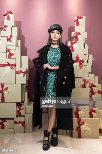 Taiwan Fashion Influencer Kiwi Lee poses for a photograph on the red carpet at the Burberry Pacific Place event on 03 November 2016 in Hong Kong,...