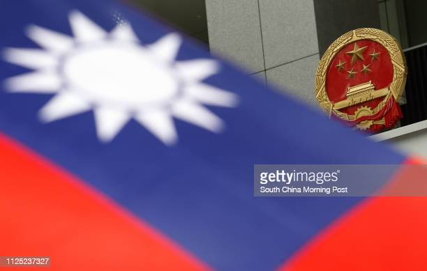 A Taiwan flag being displayed by a protester at the plaza in the new Central Government Office in Admiralty while protesters protest against the...