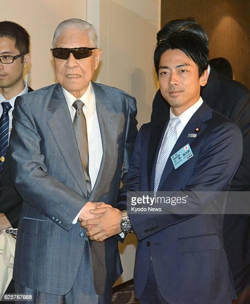 TAIPEI Taiwan Former Taiwan President Lee Tenghui and Shinjiro Koizumi a lawmaker of Japan's ruling Liberal Democratic Party shake hands in Taipei on...