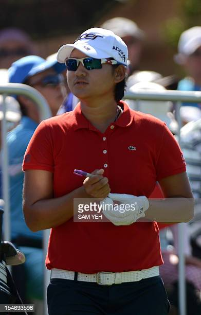 Taiwan golfer Yani Tseng autographs a ball before teeing off at Sunrise Golf and Country Club in northern Taoyuan county, on October 25, 2012. The...