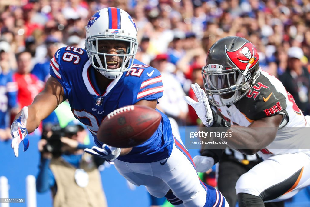 Taiwan Jones #26 of the Buffalo Bills attempts to catch the ball as Lavonte David #54 of the Tampa Bay Buccaneers defends him during the second quarter of an NFL game on October 22, 2017 at New Era Field in Orchard Park, New York.