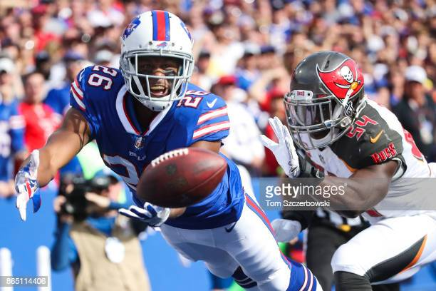 Taiwan Jones of the Buffalo Bills attempts to catch the ball as Lavonte David of the Tampa Bay Buccaneers defends him during the second quarter of an...