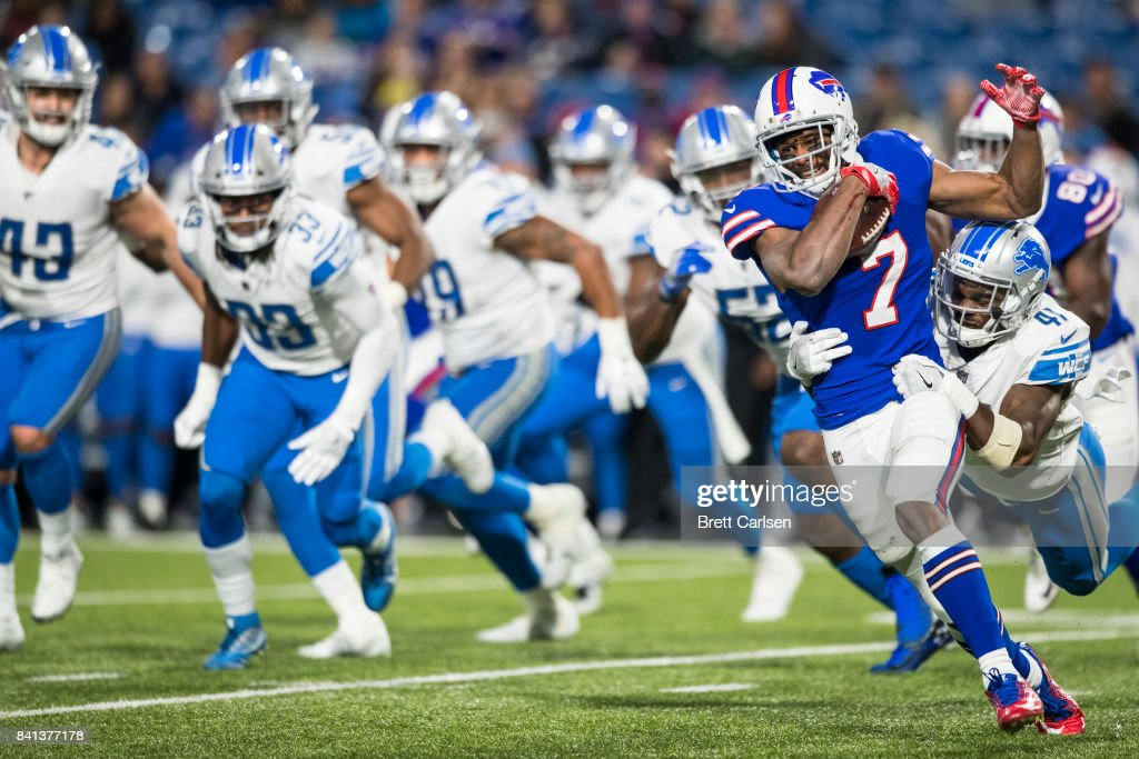 Taiwan Jones #7 of the Buffalo Bills carries the ball as he is tackled by Rolan Milligan #41 of the Detroit Lions during the second half on August 31, 2017 at New Era Field in Orchard Park, New York. Buffalo wins the preseason matchup over Detroit 27-17.
