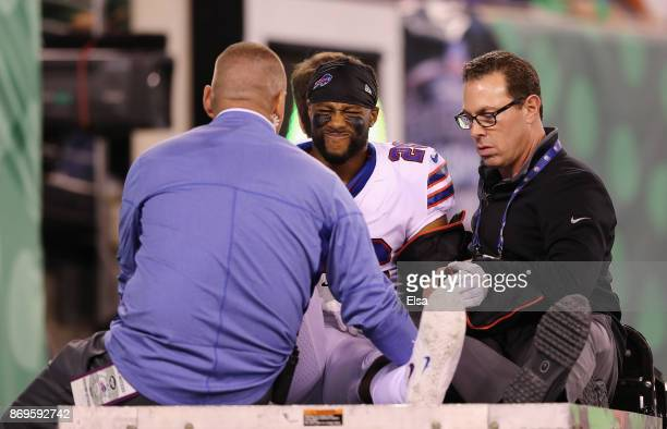 Taiwan Jones of the Buffalo Bills is carted off the field in the fourth quarter against the New York Jets during the fourth quarter of the game at...