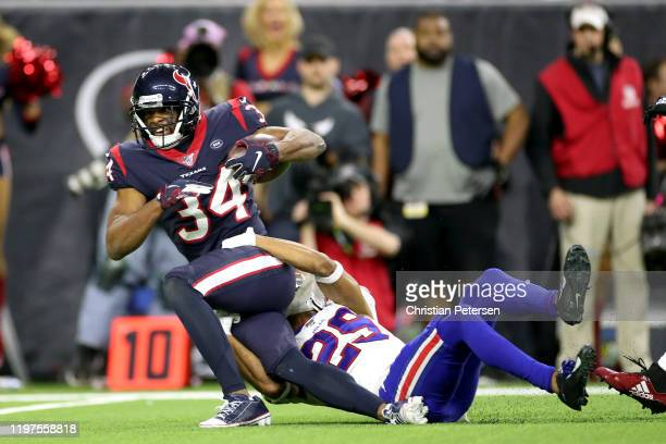 Taiwan Jones of the Houston Texans is tackled by Kevin Johnson of the Buffalo Bills after a 34yard reception during overtime in the AFC Wild Card...