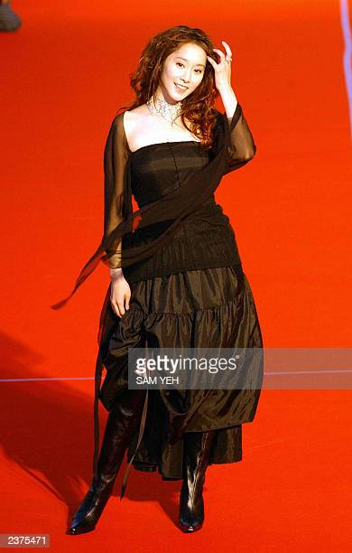 Taiwan pop singer eVonne Shi poses before the 14th Golden Melody Awards in Taipei 02 August 2003 More then 50 Taiwan Hong Kong and Singapore's...