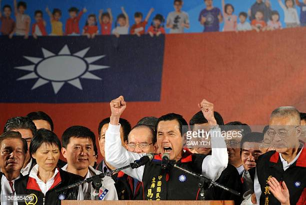 Taiwan President and ruling Kuomintang presidential candidate Ma Ying-jeou celebrates with supporters outside of the campaign headquarter in Taipei...