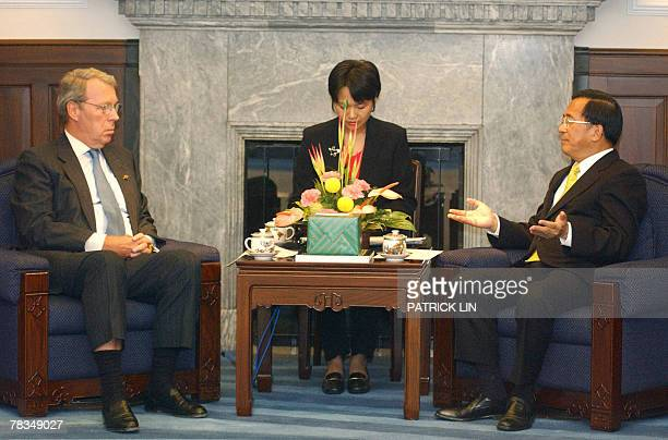 Taiwan President Chen Shuibian talks with Raymond F Burghardt the chairman of the Board of Trustees of the American Institute in Taiwan which handles...
