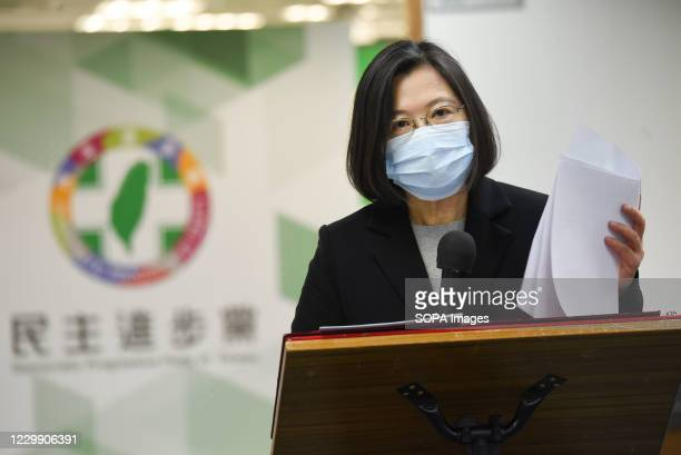 Taiwan President, Tsai Ing-wen, also chairman of Democratic Progressive Party wears a face mask as she speaks to reporters before attending the DPP...