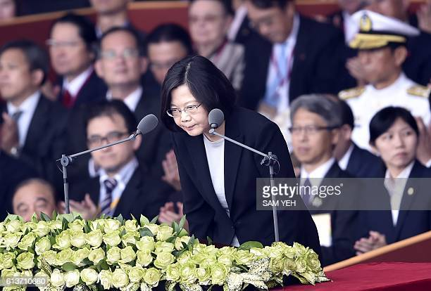 Taiwan President Tsai Ingwen bows before her speech during National Day celebrations in front of the Presidential Palace in Taipei on October 10 2016...