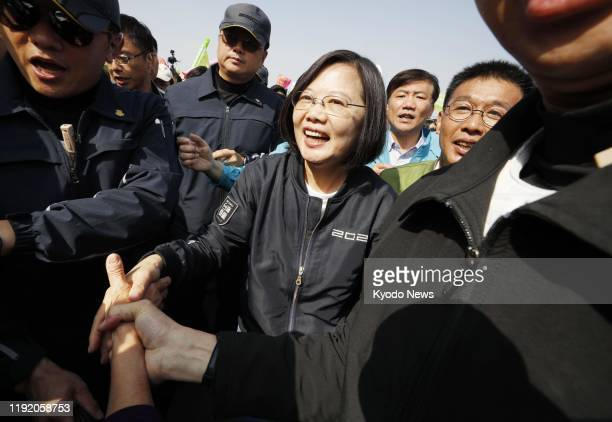Taiwan President Tsai Ingwen of the Democratic Progressive Party shakes hands with people in Kaohsiung southern Taiwan on Jan 6 ahead of the Jan 11...