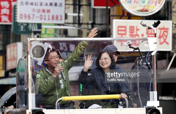 Taiwan President Tsai Ingwen of the Democratic Progressive Party waves to the crowd from an election campaign car in Kaohsiung southern Taiwan on Jan...