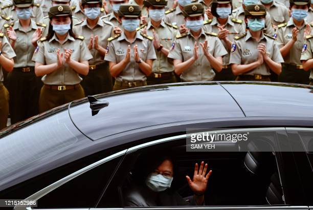 Taiwan President Tsai Ing-wen waves after inspecting the military police headquarters in Taipei on May 26, 2020.