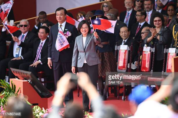 Taiwan President Tsai Ing-Wen waves during National Day celebrations in front of the Presidential Palace in Taipei on October 10, 2019. - President...