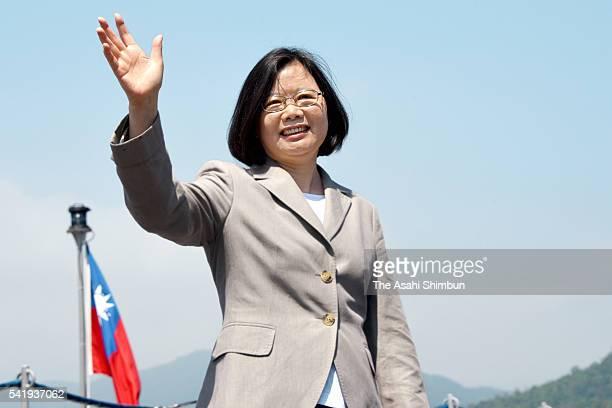 Taiwan President Tsai Ingwen waves while inspecting a Navy Vessel on June 4 2016 in Yilan Taiwan