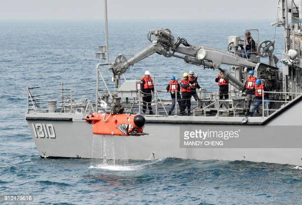 Taiwan sailors handle a remotelyoperated underwater vehicle used for neutralising naval mines during an annual drill off Tsoying naval base in...