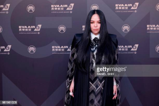 Taiwan singer AMei poses for photo upon arrival for the 29th Golden Melody Awards in Taipei on June 23 2018 Some of Mandarin pop music's biggest...