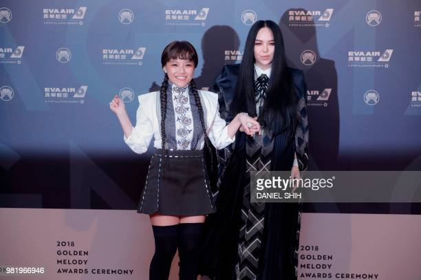 Taiwan singer AMei poses with her niece Anna for a photo upon arrival for the 29th Golden Melody Awards in Taipei on June 23 2018 Some of Mandarin...