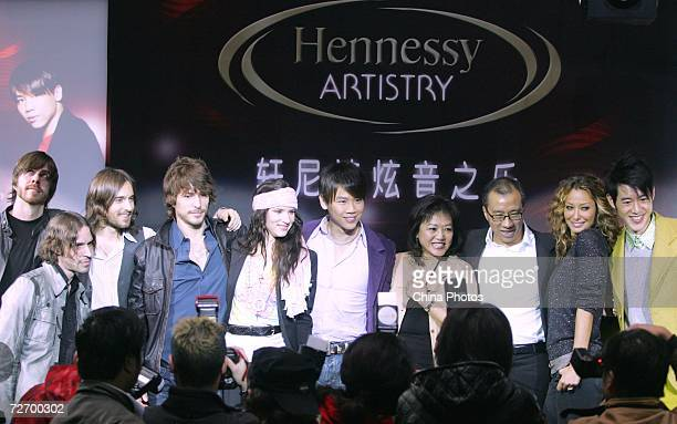 Taiwan singer David Zee Tao and Juliette Lewis attend a press conference of the Hennessey Global Artistry Tour on December 1 2006 in Shanghai China...