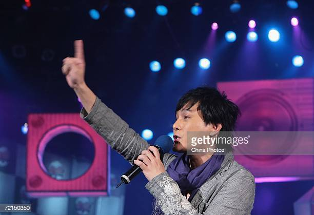 Taiwan singer Jeff Chang gestures as he performs during a fan club activity to promote his new album on October 11 2006 in Nanjing of Jiangsu...