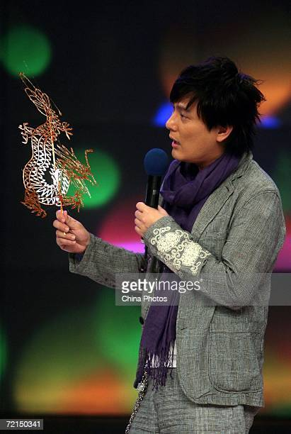 Taiwan singer Jeff Chang holds an eatable sugar dragon made by a folk artist during a fan club activity to promote his new album on October 11 2006...