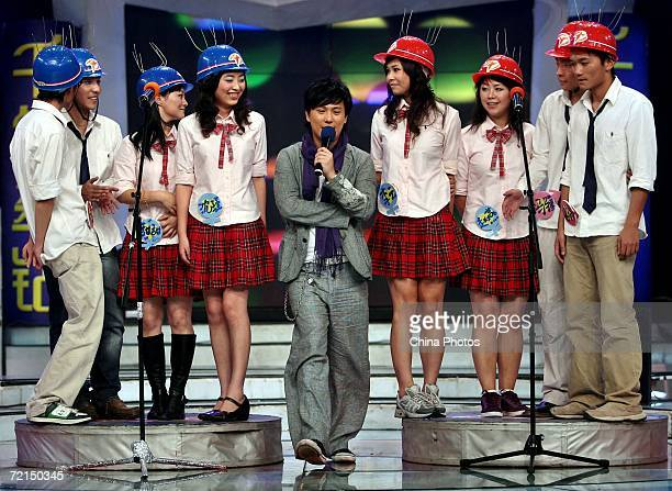 Taiwan singer Jeff Chang performs as fans stand behind during a fan club activity to promote his new album on October 11 2006 in Nanjing of Jiangsu...