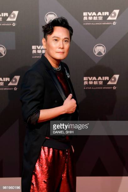Taiwan singer Jeff Chang poses for photo upon arrival for the 29th Golden Melody Awards in Taipei on June 23 2018 Some of Mandarin pop music's...