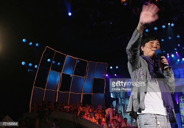 Taiwan singer Jeff Chang waves as he performs during a fan club activity to promote his new album on October 11 2006 in Nanjing of Jiangsu Province...