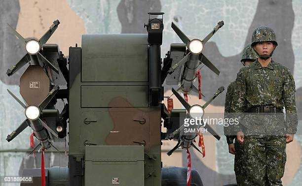 Taiwan soldiers stand next to homemade Tien Chien surfacetoair missiles during an annual drill in Tainan on January 17 2017 Taiwan began two days of...