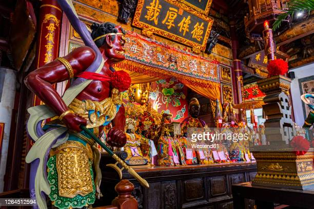 taiwan, tainan, altar and statue at grand mazu temple - taiwan stock pictures, royalty-free photos & images