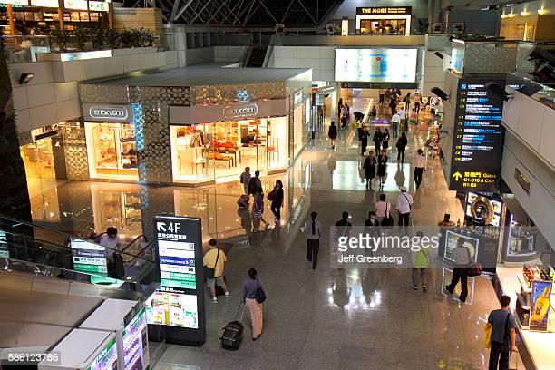 Taiwan Taoyuan International Airport TPE terminal concourse gate area Coach