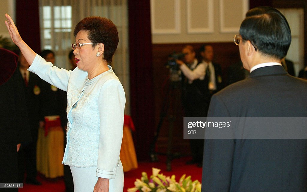 Taiwan Vice President Annette Lu swears in as President Chen Shui-Bian looks on at the presidential palace in Taipei, 20 May 2004. Chen, who has infuriated China with his vision of an independent Taiwan, defeated Nationalist leader Lien Chan by a razor-thin 0.2 percent in the March 20 election, a day after the incumbent was lightly wounded in a mysteroius assassination attempt.