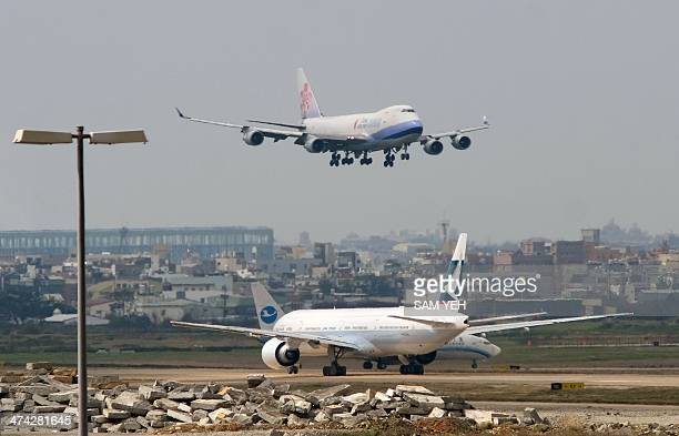 TaiwanChinaAsiaaviationtourismconstructionFOCUS by Benjamin YEH A China Airline prepares to land at Taoyuan International Airport on February 20 2014...