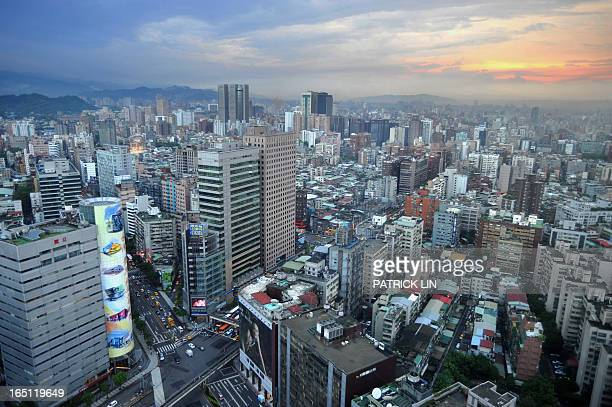 STORY TaiwaneconomypropertyFOCUS by Benjamin Yeh This photo taken on December 7 2010 shows huge property commercial signs attached on a wall of a...