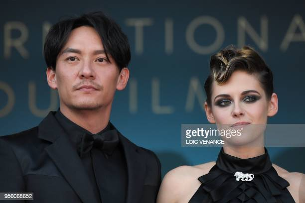 Taiwanese actor and member of the Feature Film Jury Chang Chen and US actress and member of the Feature Film Jury Kristen Stewart pose as they arrive...