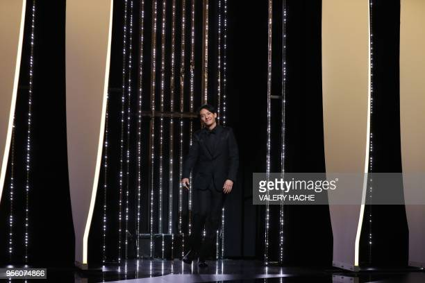 Taiwanese actor and member of the Feature Film Jury Chang Chen arrives on stage on May 8 2018 for the opening ceremony of the 71st edition of the...