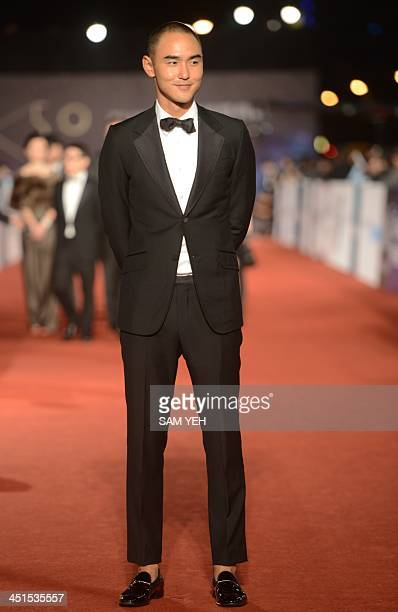 Taiwanese actor Ethan Ruan arrives ahead of the Golden Horse Film Awards in Taipei on November 23 2013 Stars from China Hong Kong Singapore and...