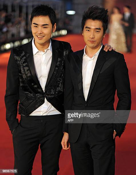 Taiwanese actors Ethan Ruan and Mark Chao pose for photographers as they arrive on the red carpet for the Hong Kong Film Awards on April 18 2010 The...