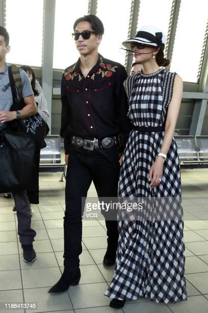 Taiwanese actress and model Lin Chiling and her husband Akira arrive at a railway station on November 18 2019 in Tainan Taiwan of China